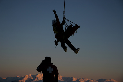 A mountain rescue team prepares for a helicopter rescue.